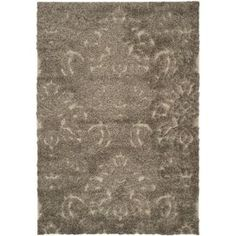 Bring a touch of texture to your dining room decor or den seating group with this artfully crafted rug, showcasing a textural damask motif in smoke and beige.    Product: Rug  Construction Material: Polypropylene  Color: Smoke and beige  Features: Power-loomed Note: Please be aware that actual colors may vary from those shown on your screen. Accent rugs may also not show the entire pattern that the corresponding area rugs have.