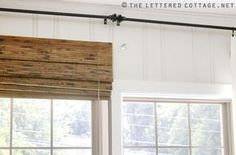 Great tip!  They mounted the blinds higher on the window. Then used a little board between to make the middle trim appear to go all the way up and therefore the window looks taller.  When totally open the whole window is open and all the light comes in.  (This pic is before the little faux trim piece is added, click to see the blog) Excellent idea!