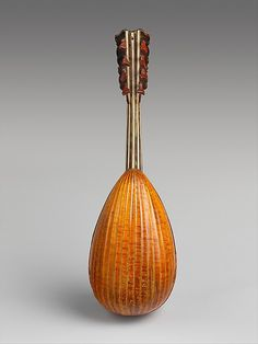 Mandolin Attributed to Vincentius Vinaccia (Italian, Naples active 1769–1795 Naples) Date: ca. 1770 Geography: Naples, Italy Medium: Spruce, maple, tortoiseshell, mother-of-pearl, ivory Dimensions: Label: 17.8 x 58.4cm (7 x 23in.) Classification: Chordophone-Lute