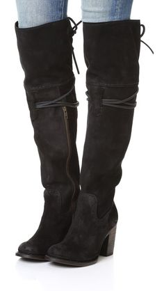 Rugged FREEBIRD by Steven over-the-knee boots in distressed suede. Thin leather straps lace-up the top line. Exposed side zip. Stacked heel and leather sole.