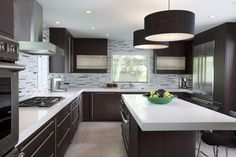 Like the backsplash going all the way to the ceiling on all kitchen wall surfaces - nice!