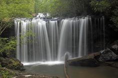 Found on the southern edge of Sumter National Forest in Oconee County, Brasstown Falls is actually a chain of three separate cascades. This is Brasstown Veil falls, the second cascade on the hike. The wide veil of water spills over a ledge and falls another 15-20 feet into a pool that invites a cooling dip on a hot day. (Photo by Ed Long in 2009.)