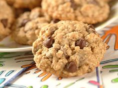 Cinnamon and oatmeal put a savory side on classic chocolate chip cookies. Raisins make them even more hearty -- and delicious!