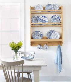Country Living's March 2015 issue styles Ralph Lauren's graphic blue and white tabletop collection, Cote D'Azur, on an old-fashioned plate rack.