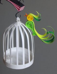 -And bird cage with free bird and a candle inside of it.