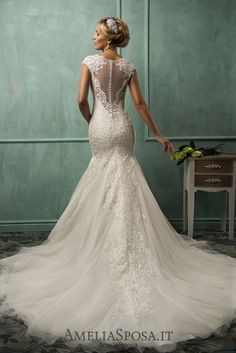 Wedding dress Lanta - AmeliaSposa.  Elegancy of laces. Alençon laces transform a sensual look into a sophisticate one that is worth a wedding ceremony. But the V-cleavage and cult back with a false nakedness effect keep a bride's right to demonstrate spicy elements.