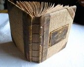Rustic wedding guest book leather and burlap 7 1/4 x 5 1/2  with names and date. $65.00, via Etsy.