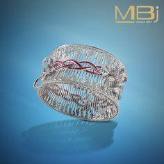 Diamond bracelet with round shaped diamonds and rubies. #diamond #ruby #fashion…