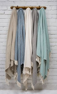 throws for chilly evenings. could put on our empty wall in the living room, add color and keep the blankets handy, yet off the furniture