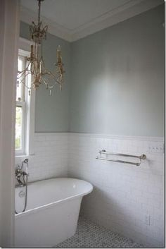 pretty simple bathroom -- i would add frames and flowers ;) it needs some more color, but i love the chandelier and tub!