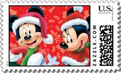 Mickey and Minnie are dressed in Santa outfits against a red snowflaked background.