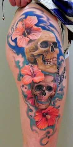 Skull and flowers leg tattoo - 50 Incredible Leg Tattoos