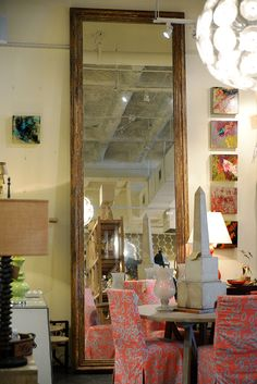 Antique #French extra large #mirror with brightly colored #slipcovered #dining #chairs and colorful wall #art at #Houston #Mecox #interiordesign #MecoxGardens #furniture #shopping #home #decor #design #room #designidea #vintage #garden