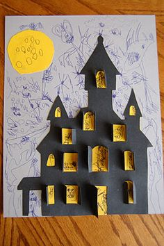 Haunted house craft. This would be cute with artic words behind the windows.