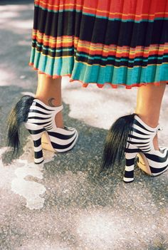 Leila Rahimi, 30, artist, model, student and illustrator, wears Gucci zebra pumps. Produced by Vogue for Gucci.
