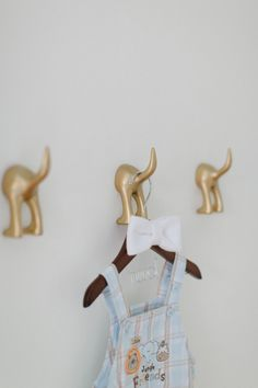 puppy dog tails hooks! get them from Ikea and spraypaint