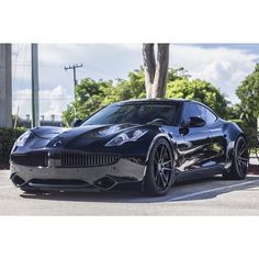Blacked out Fisker Karma #murderedout #blackedout #carsandcoffee