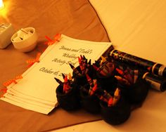 We made children's activity books with coloring pages that were wedding and Halloween themed.  We tied them together with a three hole punch and fall ribbons.  They got little cauldrons with crayons.