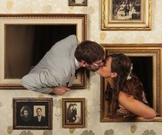 cute engagement picture, surrounded by pictures of couples in the family