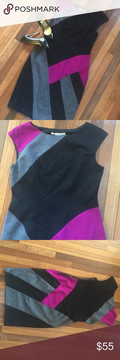 "Maggy London Color Block Midi Dress Size 10 Color Block dress in black , grey , and purple by Maggie London .  Form fitted and figure flattering dress .  Fully lined , exposed size zipper .  Perfect condition .  All measurements taken flat .  Size 10 measures shoulder to hem 37.5"", armpit to armpit 17.5"", waist 15"", Hips 19"".  Bundle 2+ and Save 20% Maggy London Dresses Midi"