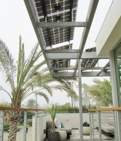 The LSX custom solar awning array provides shade as it wraps around the house along the upper deck walkway.