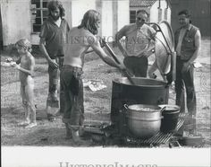 WATCH-FIELD FREE HIPPIE FESTIVAL.1975..COOKING FOOD BY THE  FREE CANTEEN..