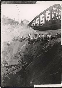 Men working alongside a steam navvy