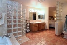Eclectic Master Bathroom with Raised panel, MS International Travertine 4x4 Tumbled Durango Cream, Double sink, High ceiling