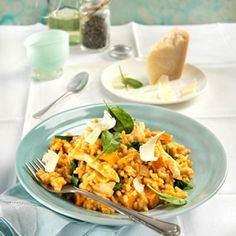 A delicious risotto with pumpkin, chicken and spinach finished with a generous sprinkle of parmesan cheese