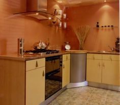In feng shui, the kitchen is admired as one of the best important apartment for health, happiness, and wealth. It's additionally one of the trinity Galley Style Kitchen, Kitchen Design, Orange Kitchen Walls, Kitchen Flooring, Kitchen Cabinets, Light Wood Cabinets, Feng Shui Tips, Floor Colors, Herd