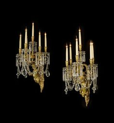 * An Important Pair of Gilt-Bronze and Cut-Glass Figural Six-Light Wall Appliqués.  French, Circa 1890.