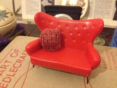 Thought I would try knitting a cushion, not so sure about the scale or the colour