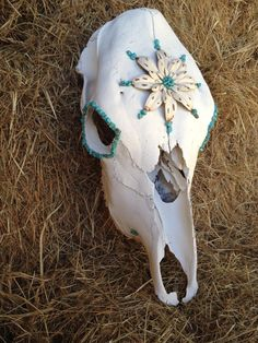 Miss Daisy- Cute as can be. She is 100% real cow skull decorated with a Metal Daisy and accented in turquoise beading. She would make a great gift for that little cowgirl in your life. Her and her friends can be found on Etsy! Keywords: Skulls, Rustic, Vintage, Glam, Turquoise, Country, Western, Decor, Cowgirl, Rodeo, Taxidermy