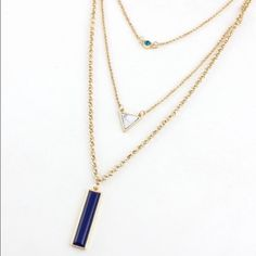 Layered Necklace This gold necklace has a turquoise crystal, marble stone and navy stone. Beautiful piece for spring Jewelry Necklaces