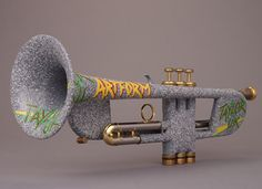 """The Freddie Flintstone custom shop """"Rock'n Roll Artform"""" Trumpet by Andy Taylor, Norwich with graffitied concrete-imitation exterior Play Trumpet, Brass Music, Brass Instrument, African American Artist, French Horn, Saxophone, Musical Instruments, Art Boards, Horns"""