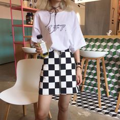 """Checkered Skirt + Japanese """"Idea"""" T-shirt sold by storecococo. Shop more products from storecococo on Storenvy, the home of independent small businesses all over the world."""