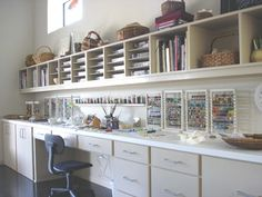 Who wouldn't be inspired in the clean and crisp beading studio? California Closets Baltimore can help you create a room as fresh as this!