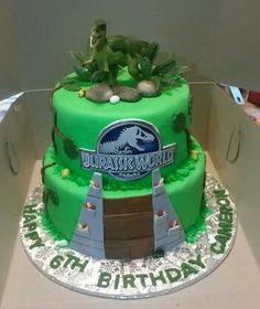 2 Tier Jurassic World Themed Birthday Cake 2 Tier Jurassic World themed Birthday Top Tier: Chocolate Bottom Tier:. Birthday Party At Park, 6th Birthday Cakes, Paw Patrol Birthday Cake, Dinosaur Birthday Cakes, Birthday Stuff, Dinosaur Party, Dinosaur Cakes For Boys, Dinosaur Cake Toppers, Dino Cake