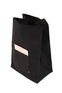 Waxed canvas roll-top lunch bag, hand made in Pennsylvania by Peg & Awl Handcrafted, lookin' good, holdin' just the perfect amount of foods to fill ya up. These bags are outfitted with a pocket on the