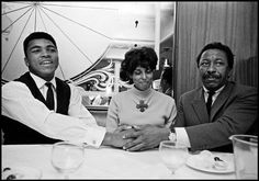 Muhammad Ali in a restaurant with photographer Gordon Parks & his wife