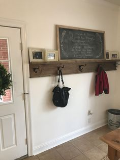 Diy entryway coat rack with picture ledge shelf! We needed something to hang coats, backpacks etc by the back door & this fits the bill perfectly! Stained with Miss Mustard Seed Curio then sealed with dark wax. Chalkboard was a diy(plywood cut down the 1x2 for the frame). Hooks are from Hobby Lobby!