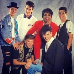 The other time Joey's jeans tore just before his photo shoot with Oprah and he tried to hide behind Donnie but we could still totally see the rip. | 25 Boy Band Photo Shoots That Went Horribly Wrong