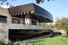 A twisting labyrinth of sculptural rock and glass, this cutting edge zen house by Spanish modelers A-cero puts forth an extraordinary expression inside its lavish surroundings. Situated in Pozuelo de Alarcon in Madrid