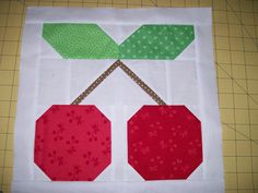 Podunk Pretties: Block 2, Cherry Block.. My suggestion would be to cut and make one block, just in case.  Also there's tons of scrap with this quilt.  If you don't like working with leftover HSTS this quilt block isn't for you