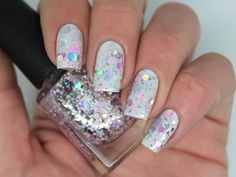 """""""Bellissima"""" is a 5 free hand-blended, custom nail polish. (Toluene, Formaldehyde, TSF resin, Camphor and DBP free)BASE - Clear.GLITTER - Holographic silver, matte pink and holographic lavender dots and hexes.Fishing MAY be required as the large glitters have a tendency to sink and slide off the brush. A gentle shake before use will help distribute the glitter.OPAQUE - N/A (designed to be worn over a base colour)PHOTO SHOWS - One coat of """"Bellissima""""..."""
