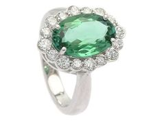CLUSTER RING, 18K white gold, verdelite tourmaline approx 3,50 cts, certificate IGI F4J85635, 16 brilliant cut diamonds approx 0,90 ctw, approx R-TW/VS (2 small notches), size 17,25 mm, weight 7,8 g. #jewelry #emerald #ring #Diamonds #jewelryauction
