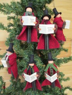 Christmas Caroler Gentleman Ornament Handmade by ModerationCorner...we've created this Victorian inspired gentleman to accompany our similarly styled lady caroler introduced last year. Each caroler wears a long coat of red wool felt lined with dark brown fur, green vest with black buttons and a wool scarf. He carries a miniature Christmas Carol book of actual carols shrunk to size.