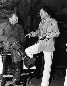 Frank Sinatra visits Van Johnson on the set of Battleground, 1949
