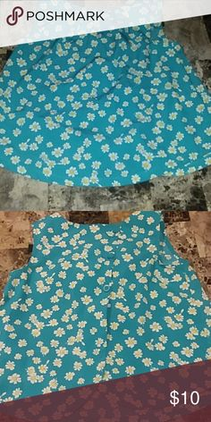 cute tank top. turquoise scoop neck tank top with daisies on it. three buttons on the back. Old Navy Shirts & Tops Tank Tops
