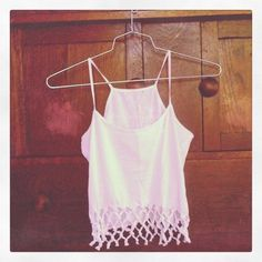 """I DIY'd: Lattice Hem Crop Tank  The """"I DIY'd"""" series, Part Dos. In preparation for summer BBQ's, this week I tackled a DIY post from Clones and Clowns  Attempt #2: Crop Tank with Lattice TrimThis faux crochet-trim tank is getting paired with my high waisted denim shorts this summer. Don't have a tank to play with? Shop printed tanks at SWELL http://www.swell.com/Womens-Tanks. Hardest part: Assuming you do not have kitty cats (lots of strings involved), then patience. (By Nicki H., Swell.com)"""